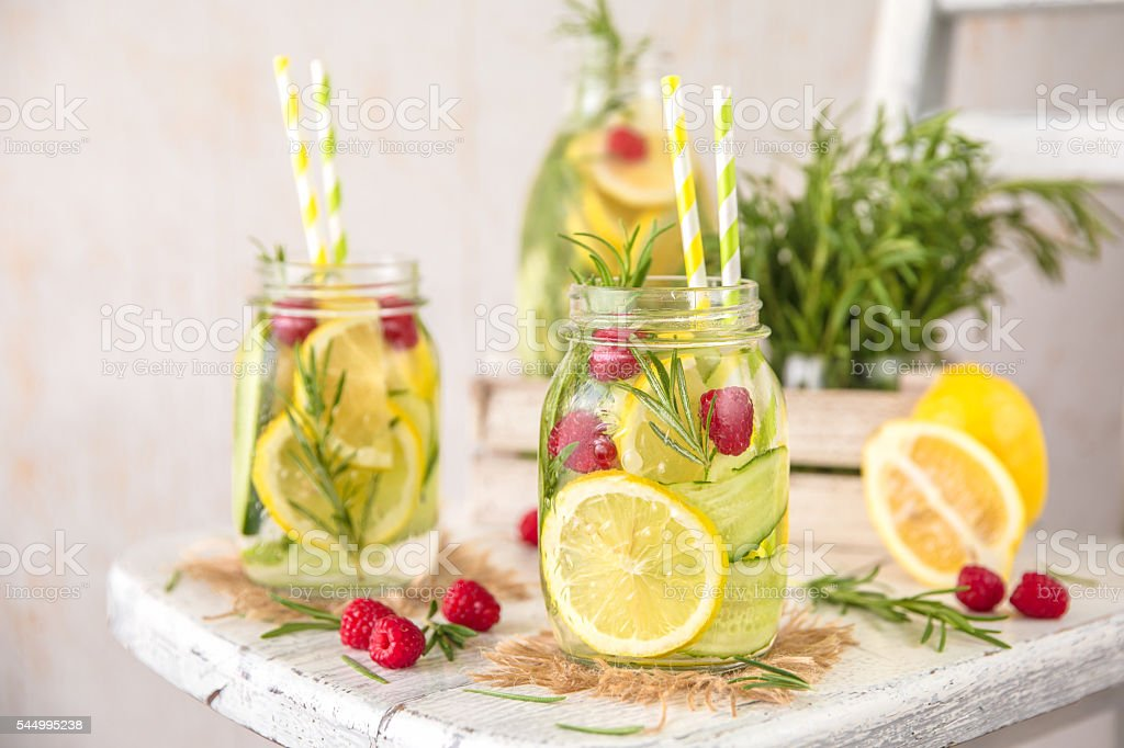 Detox Water with lemon, cucumber, raspberry and rosemary stock photo