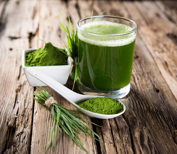 detox. young barley, chlorella superfood. - antioxidant stock photos and pictures