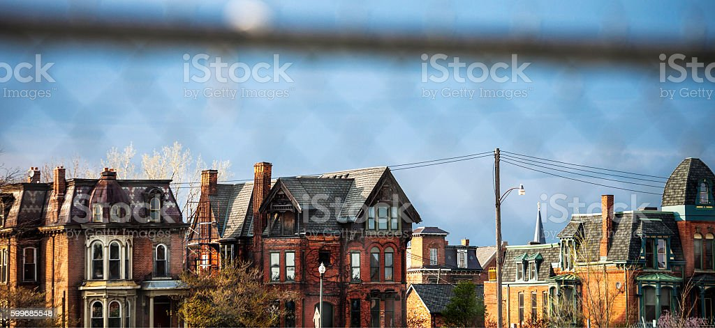 Detroit homes seen through fence. stock photo