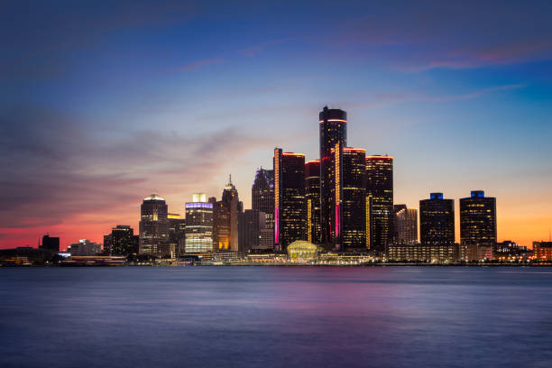 Detroit, Michigan at Dusk A cityscape of Detroit, Michigan at dusk. detroit michigan stock pictures, royalty-free photos & images