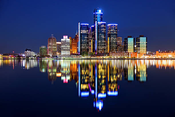 Detroit Michigan skyline reflecting on the Detroit River Downtown Detroit skyline reflection on the Detroit River detroit michigan stock pictures, royalty-free photos & images