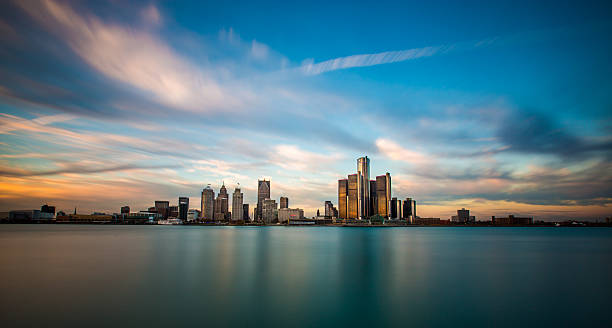 Detroit Panorama A panorama of the Detroit, Michigan skyline, as seen from across the Detroit River in Windsor, Ontario. detroit michigan stock pictures, royalty-free photos & images