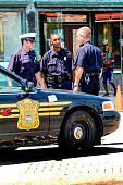 Detroit, MI, USA - July 16 2006: Detroit Police Department Officers in Fox Town on a sunny summer's day