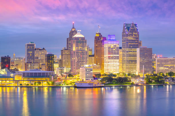 Detroit skyline in Michigan, USA at sunset Detroit skyline in Michigan, USA at sunset shot from Windsor, Ontario Canada urban sprawl stock pictures, royalty-free photos & images