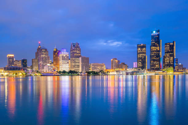 Detroit skyline in Michigan, USA at sunset Detroit skyline in Michigan, USA at sunset shot from Windsor, Ontario Canada detroit michigan stock pictures, royalty-free photos & images