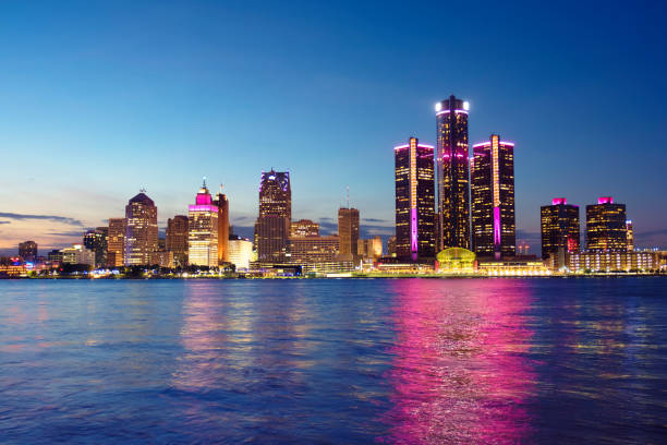Detroit skyline reflected in water during sunset Detroit skyline reflected in water during sunset detroit michigan stock pictures, royalty-free photos & images