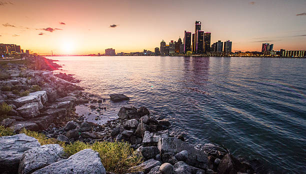 Detroit Sunset Detroit Sunset detroit michigan stock pictures, royalty-free photos & images
