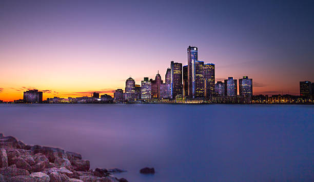 Detroit Twilight A view of Detroit, Michigan from across the Detroit River, in Windsor, Ontario.  Twilight hour. detroit michigan stock pictures, royalty-free photos & images