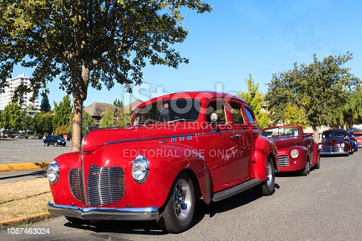 Victoria, Canada- July 25, 2016: The largest collection of Deuces anywhere staged all around the beautiful Victoria Inner Harbor. Northwest Deuce Day is a sight to see!