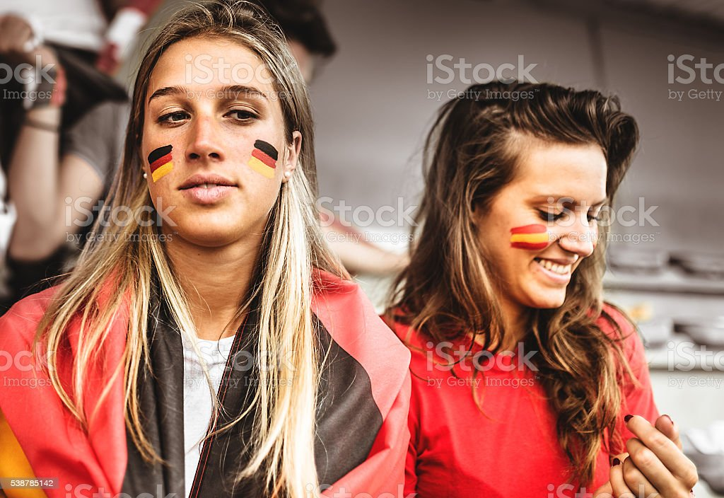 deutsch and spanish supporter at the soccer stadium stock photo