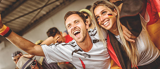 deutsch supporter at the soccer stadium - sports championship stock photos and pictures