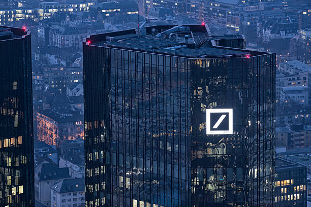 Deutsche Bank Building Frankfurt Germany Frankfurt, Germany-March 6, 2014 : View at the Deutsche Bank Building at dusk.  The Deutsche Bank is a global Bank headquartered in Frankfurt, Germany. AM stock pictures, royalty-free photos & images
