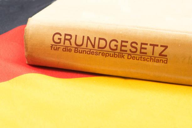 Deutsche Fahne und das Grundgesetz stock photo