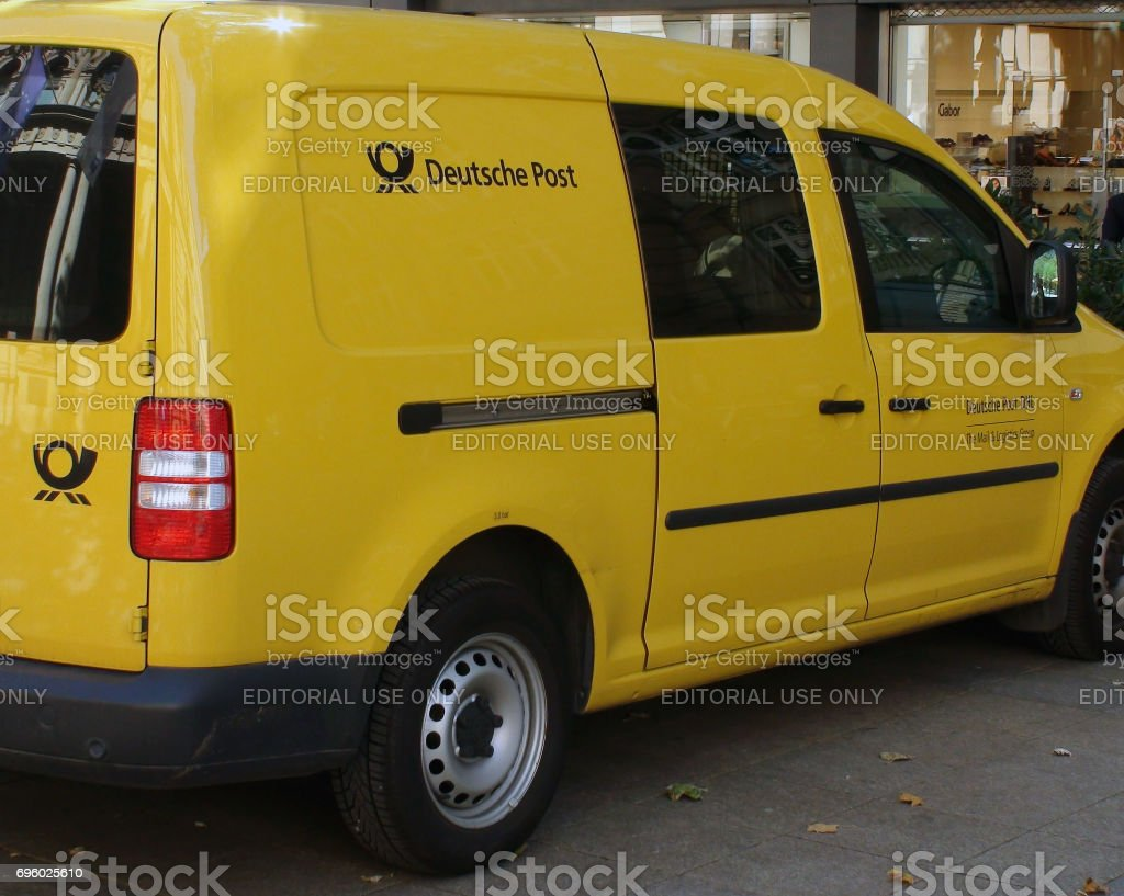 Deutsche Post Package Delivering Van Vehicle Parked On The Street At Frankfurt Germany Western Europe stock photo