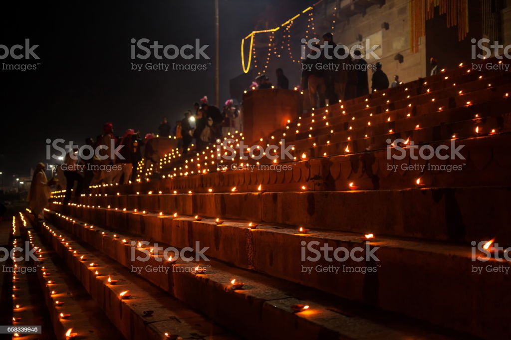 Dev Deepawali festival - Earthen lamps are lit on the stairs leading to the Ganges - Photo