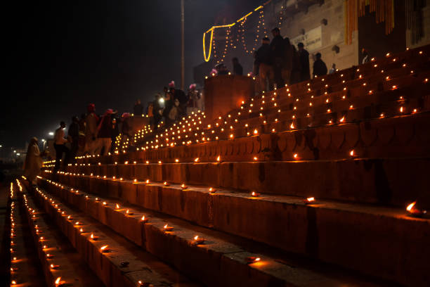 dev deepawali festival - earthen lamps are lit on the stairs leading to the ganges - ディワリ ストックフォトと画像