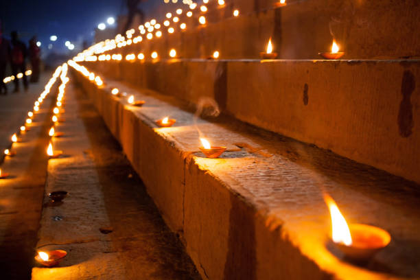 Dev Deepawali festival - Earthen lamps are lit on the stairs leading to the Ganges stock photo