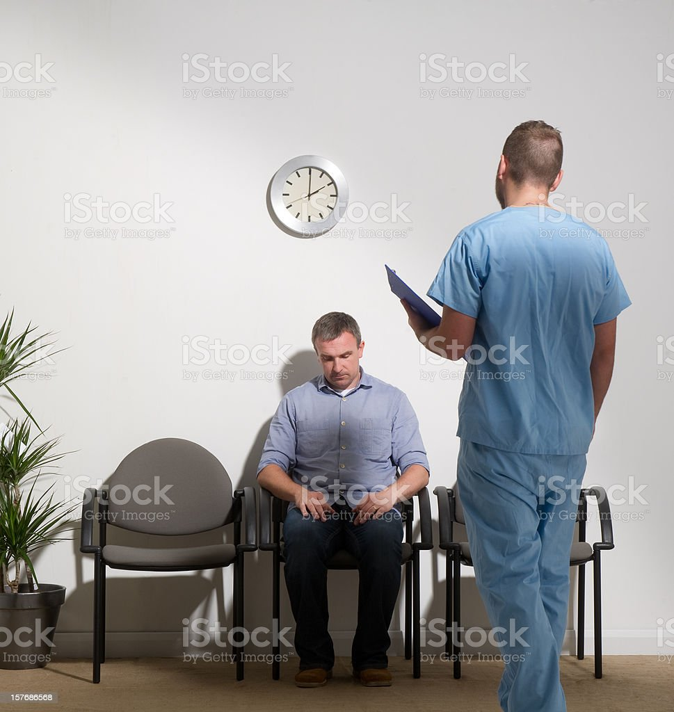 devastated man in a Hospital Waiting Room royalty-free stock photo
