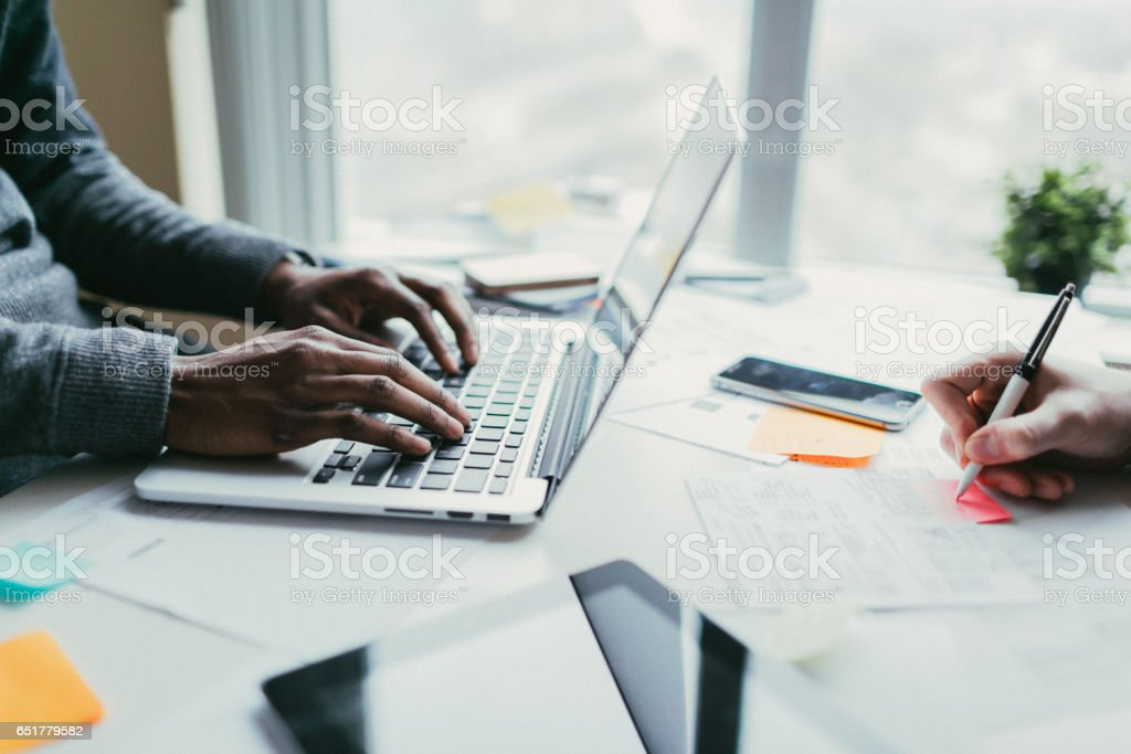 Developer and designer collaborating on a project stock photo