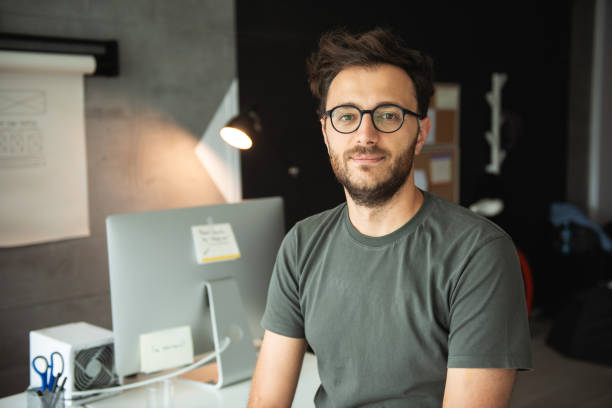 Developer in office Casually dressed caucasian guy posing in office. software developer stock pictures, royalty-free photos & images