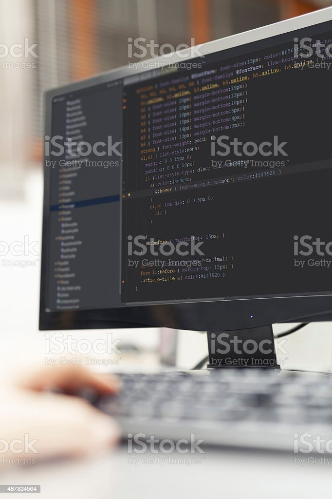 Developer working on backend source codes on computer at office. stock photo