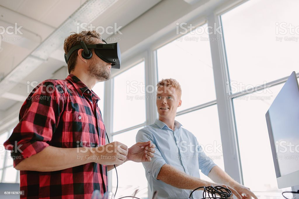 Developers testing an virtual reality device stock photo