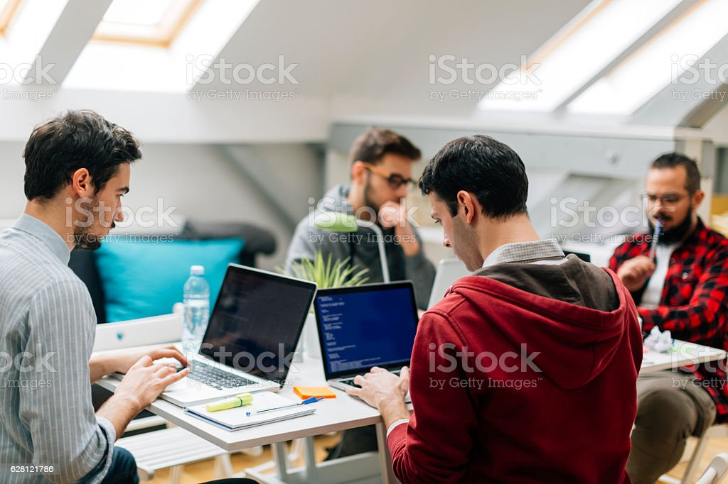 Developers Working In Their Office. stock photo