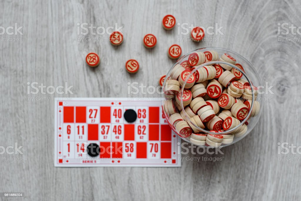 Developing bingo table game old lotto game with wooden elements and...
