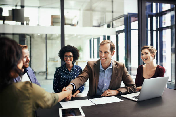 Developing business interests by striking up a deal stock photo