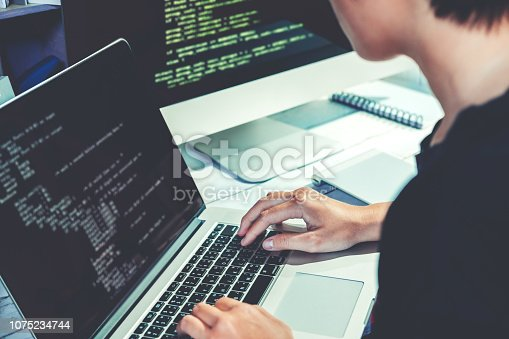 518433812istockphoto Developing programmer Development Website design and coding technologies working in software company office 1075234744