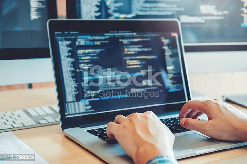518433812istockphoto Developing programmer Development Website design and coding technologies working in software company office 1131299309