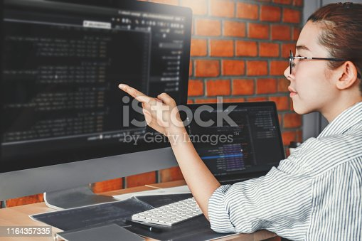 698430010 istock photo Developing programmer reading computer codes Development Website design and coding technologies. 1164357335
