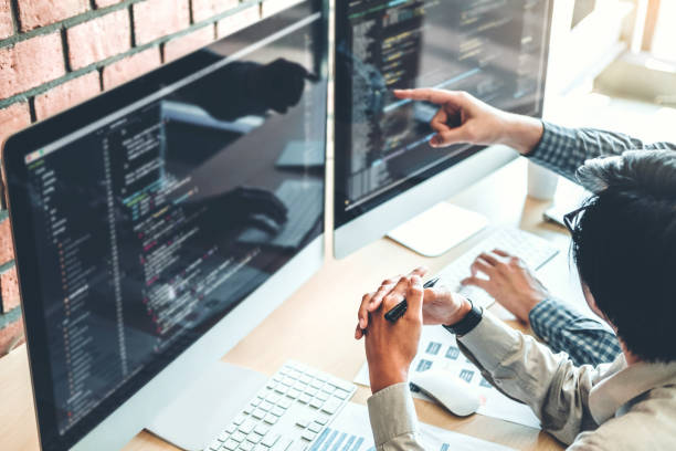 developing programmer team development website design and coding technologies working in software company office - web designer stock photos and pictures