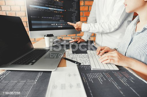 698430010 istock photo Developing programmer team reading computer codes Development Website design and coding technologies. 1164357233