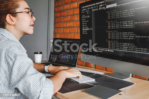 698430010 istock photo Developing programmer team reading computer codes Development Website design and coding technologies. 1221130601