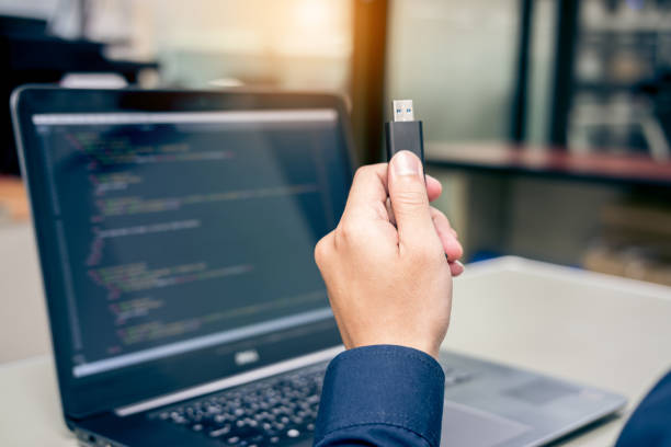 Developing programming and coding technologies on desk white Developing programming and coding technologies on desk white, Website design, Programmer working in a software develop company office,Data processing center usb stick stock pictures, royalty-free photos & images