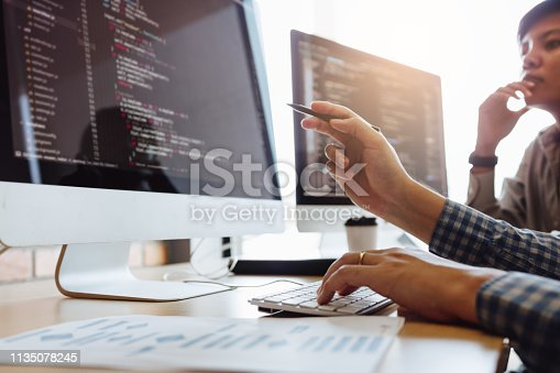istock Developing programming and coding technologies working in a software engineers developing applications together in office. 1135078245