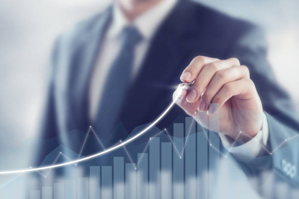 Development and growth concept. Businessman plan growth and increase of positive indicators in his business. stock photo