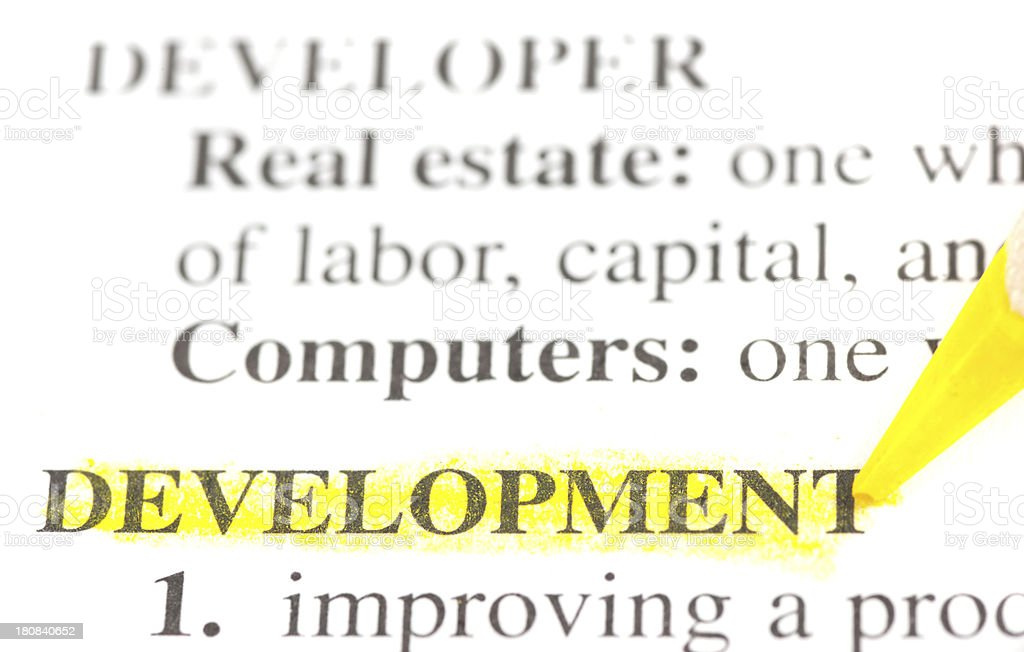 development defintion word marked in dictionary stock photo