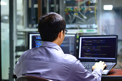 Development Of Programming And Encryption Technologies Web Site Design Programmer Must Have Screen For Displaying The Website And The Screen For Displaying His Coding Stock Photo - Download Image Now