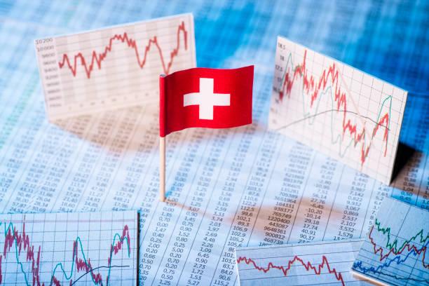 Development of the Swiss economy Schweizer Flagge mit Kurstabellen und Grafiken zur wirtschaftlichen Entwicklung. swiss culture stock pictures, royalty-free photos & images