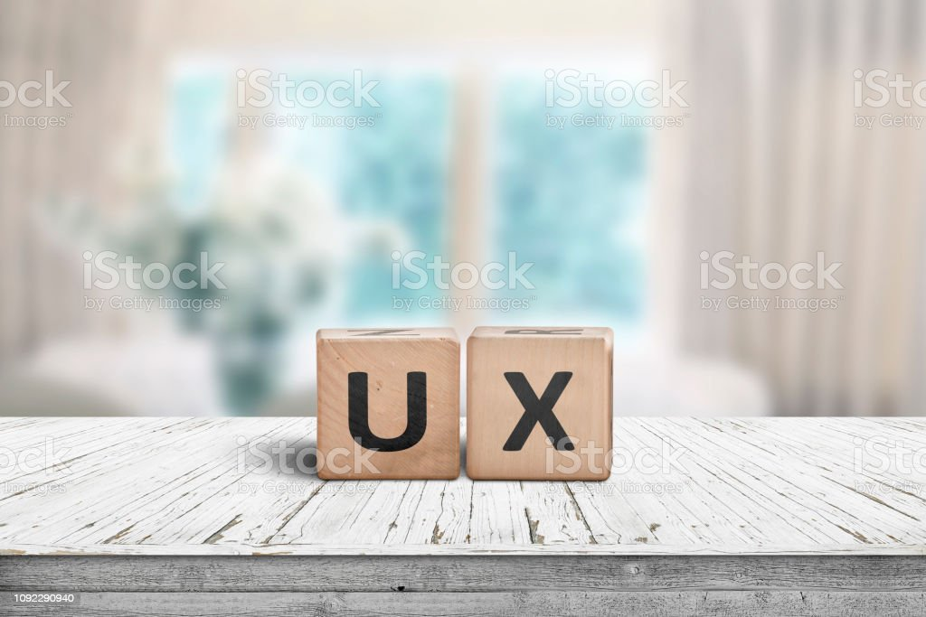 UX development sign on a table in a bright room stock photo