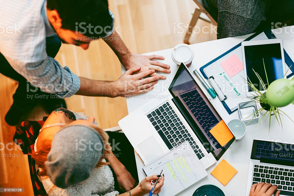 Development Team Cooperating In Their Office. stock photo