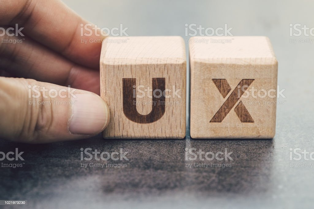 UX development, User Experience design concept, hand building cube wooden block with alphabet U and X on blackboard, user centric in modern world business, product and service design UX development, User Experience design concept, hand building cube wooden block with alphabet U and X on blackboard, user centric in modern world business, product and service design. Accessibility Stock Photo