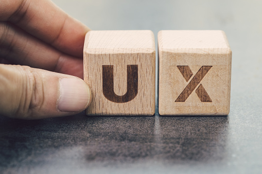 Ux Development User Experience Design Concept Hand Building Cube Wooden Block With Alphabet U And X On Blackboard User Centric In Modern World Business Product And Service Design Stock Photo - Download Image Now
