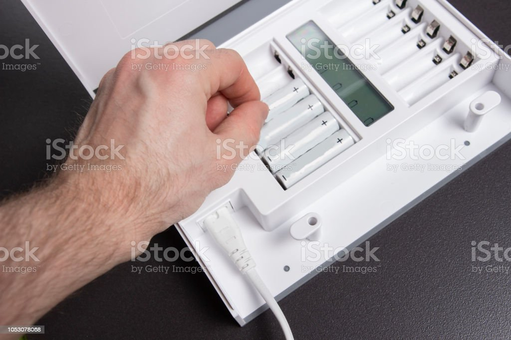 Device for charging AA batteries. stock photo