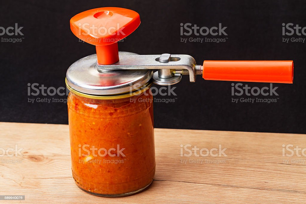 Device for closing cans stock photo