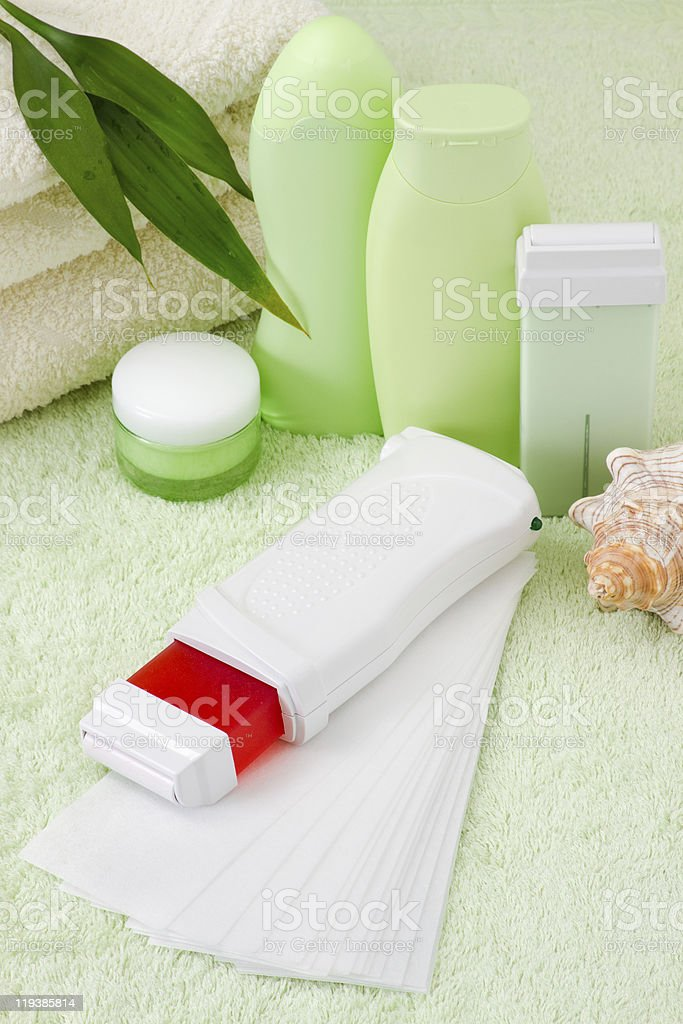 device for hair removal with wax from her legs royalty-free stock photo