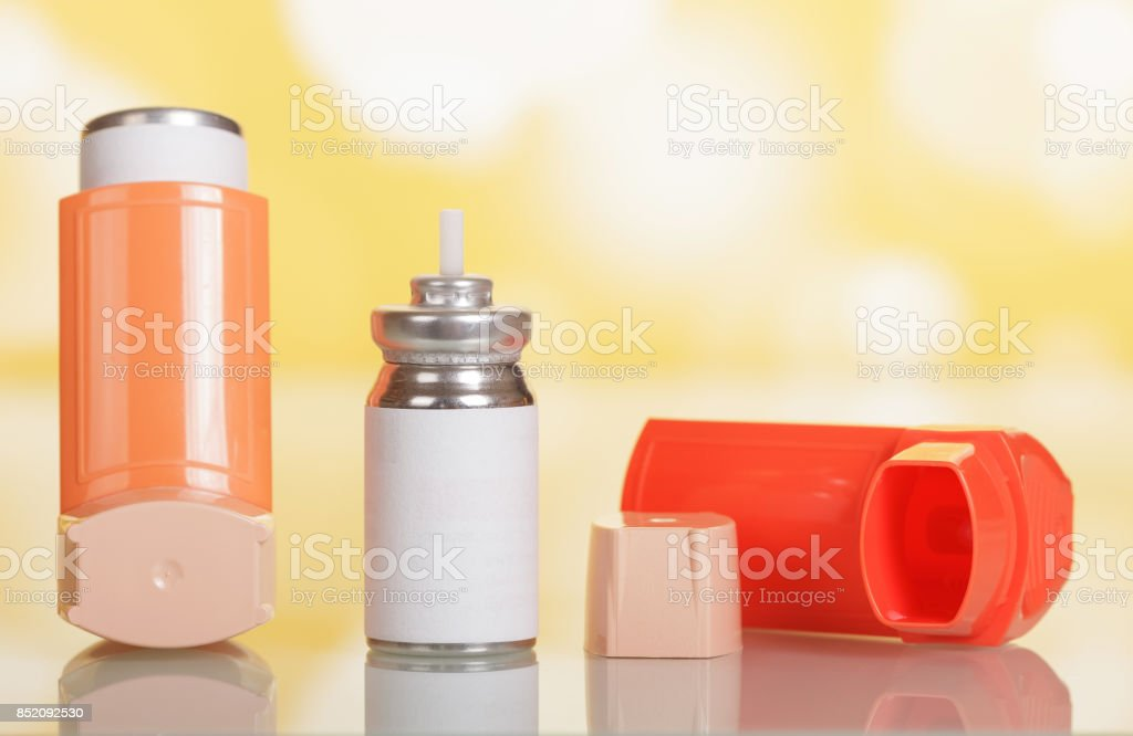 Device for inhalation and capsule with medicine on yellow stock photo