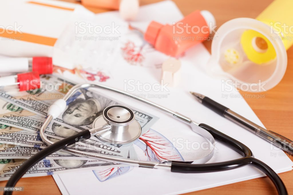 Device for inhalation, inhaler spacer for kids and phonendoscope on the table stock photo
